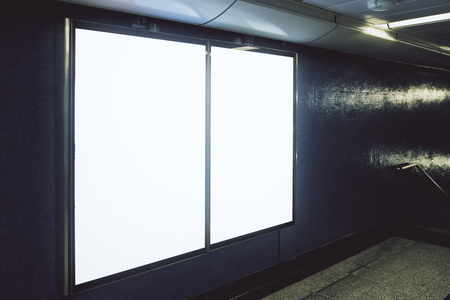 Side view of empty white subway banner on gray wall. Advertisement and urban concept. Mock up