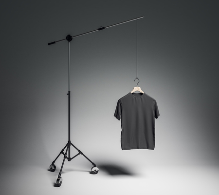 Empty black tshirt in photo studio with professional lighting equipment. Fashion, design and mockup concept. 3D Rendering Banco de Imagens