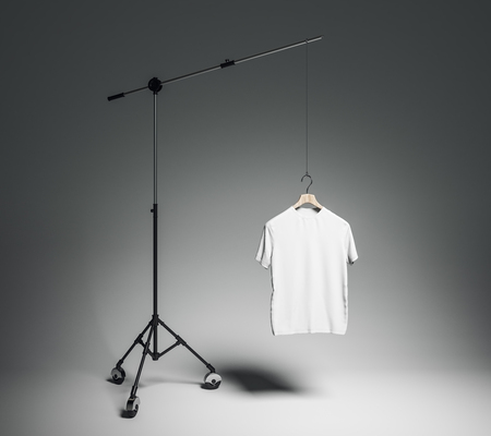 Empty white tshirt in photo studio with professional lighting equipment. Fashion, design and mockup concept. 3D Rendering