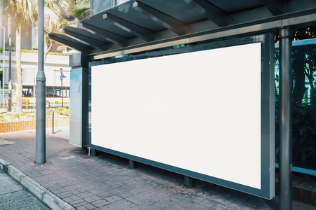 Side view of blank white horizontal billboard at bus stop. Commercial concept. Mock up