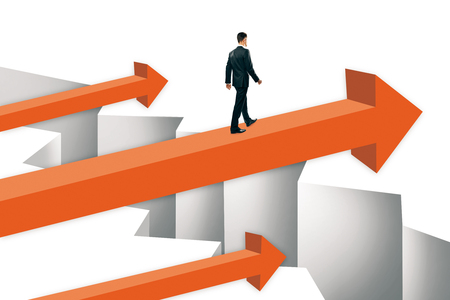 Businessman walking on orange arrows over gap. Challenge and overcoming problems concept. Stock Photo