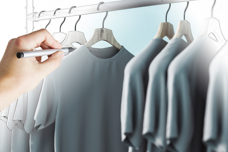 Hand drawing row of grey tshirts on hangers. Style, fashion and designer concept. 3D Rendering