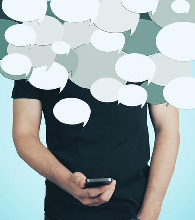 Unrecognizable man using smartphone with abstract speech bubbles. Communication concept