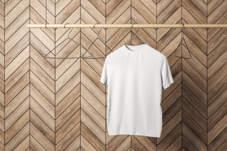 Empty one white tshirt on hanger. Wooden tile wall background. Design, store and style concept. Mock up, 3D Rendering Stock Photo
