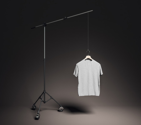 Empty gray tee in photo studio with professional lighting equipment. Fashion, design and mockup concept. 3D Rendering