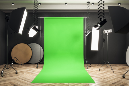 Modern photo studio interior with green background, professional equipment and wooden floor. Mock up, 3D Rendering
