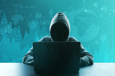 Hacker using laptop with forex chart. Criminal and trade concept. Double exposure Stock fotó