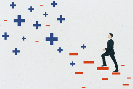 Young businessman climbing abstract plus and minus ladder on concrete wall background. Medicine, health and ambition concept