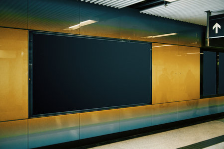 Side view of empty black subway banner on orange wall. Advertisement and urban concept. Mock up Banque d'images - 117608843