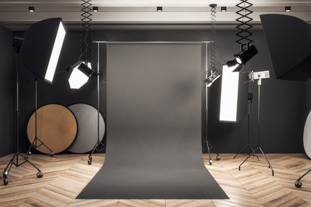Modern photo studio interior with black background, professional equipment and wooden floor. Mock up, 3D Rendering