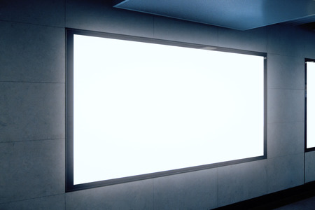 Side view of empty white subway billboard on gray wall. Advertisement and urban concept. Mock up Stock Photo