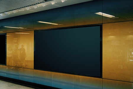 Side view of empty black subway billboard on orange wall. Advertisement and urban concept. Mock up Banque d'images - 117593276