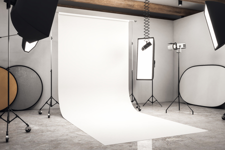 Side view of modern photo studio interior with white background, professional equipment and concrete floor. Mock up, 3D Rendering