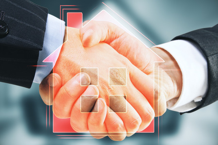 Handshake with digital house icon on blurry background. Real estate and teamwork concept. Double exposure Stock Photo