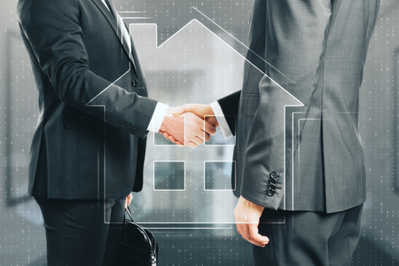 Handshake with digital house icon on blurry background. Real estate and deal concept. Double exposure