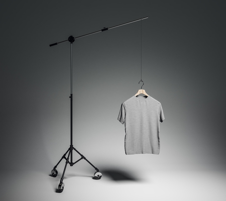 Empty gray tshirt in photo studio with professional lighting equipment. Fashion, design and mockup concept. 3D Rendering Banco de Imagens