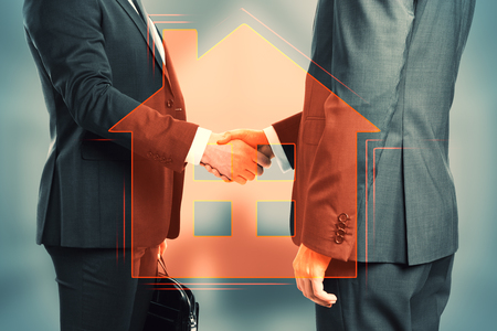Handshake with digital house icon on blurry background. Real estate and mortgage concept. Double exposure Stock Photo
