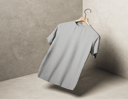 Abstract levitating grey tshirt on hanger in concrete corner with shadow. Store, fabric, fashion and mockup concept. 3D Rendering