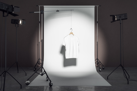 Clean white tshirt in photo studio with professional lighting equipment. Fashion, design and mockup concept. 3D Rendering Stock Photo