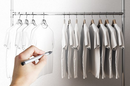 Hand drawing row of grey tshirts on hangers. Style, fashion and design concept.