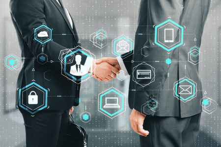 Side view of businessmen shaking hands in blurry office interior with digital interface. Social network and partnership concept. Double exposure Stock Photo