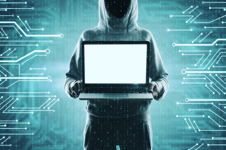 Hacker holding empty laptop on abstract digital circuit background. Malware and ad mockup concept