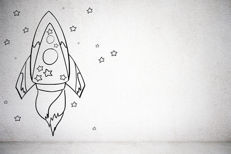 Creative rocket sketch on concrete wall background. Startup and project concept