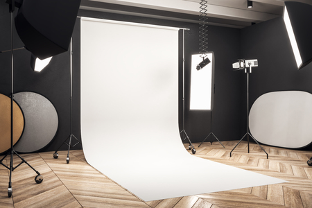 Side view of modern photo studio interior with white background, professional equipment and wooden floor. Mock up, 3D Rendering Stok Fotoğraf