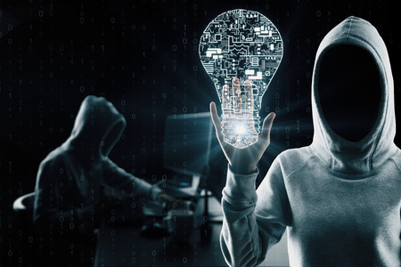 Hacker with circuit lamp on abstract dark background. Engineering and hacking concept