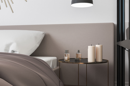 Close up of candles and perfume on bedside table in modern bedroom. Design concept. 3D Rendering Stockfoto - 118031592