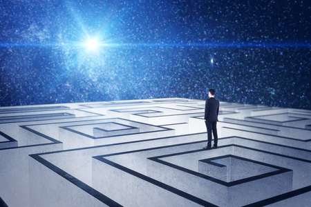 Thoughtful businessman on creative labyrinth background in space starry sky. Challenge and think concept.
