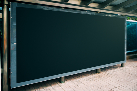 Side view of empty black bus stop billboard. Transport and advertisement concept. Mock up