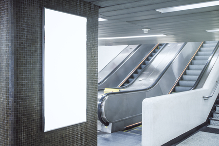 Side view of empty white banner in underground with escalator. Advert concept. Mock up