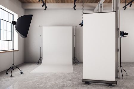 Modern photo studio interior with empty poster and daylight. Mock up, 3D Rendering