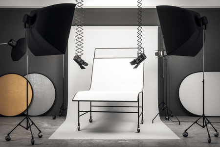 Contemporary photo studio interior with professional equipment and empty white background table. Mock up, 3D Rendering