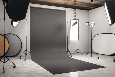 Side view of modern photo studio interior with black background, professional equipment and concrete floor. Mock up, 3D Rendering Stok Fotoğraf