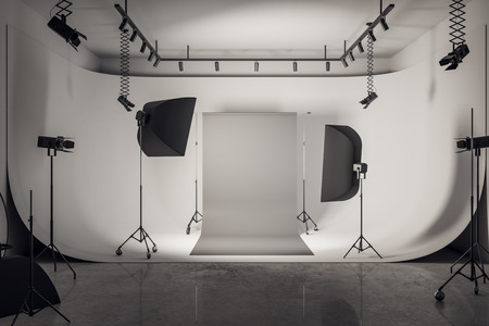 Modern loft photo studio interior with professional equipment and gray background. 3D Rendering