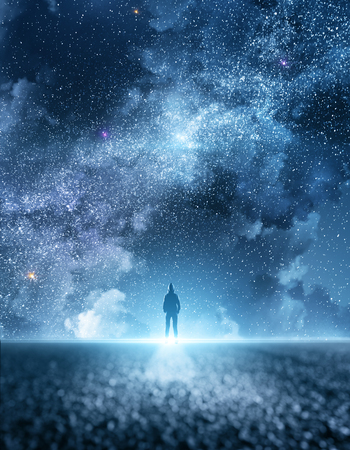 Person on road with beatiful starry night sky with clouds background. Freedom and ambition concept