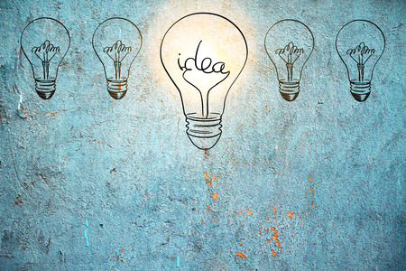 Creative drawn lamps on concrete wall background. Idea and ambition concept Stock Photo