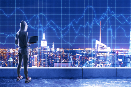Hacker using laptop on rooftop with forex chart grid and night New York city view. Attack and analysis concept. Double exposure Stock Photo - 118037363