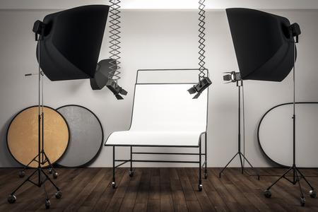 Modern photo studio interior with professional equipment and empty white background table. Mock up, 3D Rendering
