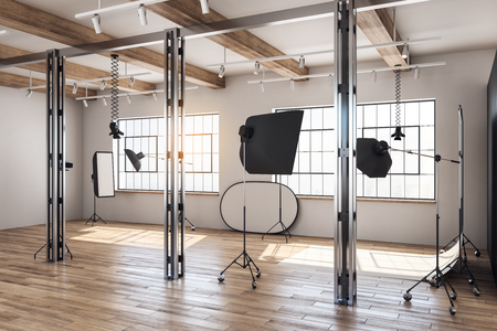 Daylit loft photo studio interior with professional equipment and background. 3D Rendering