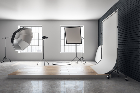 Minimalistic concrete photo studio interior with professional equipment. Photography and design concept. 3D Rendering Stock Photo