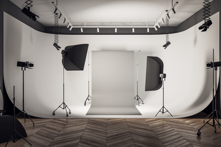 Contemporary loft photo studio interior with professional equipment and gray background. 3D Rendering