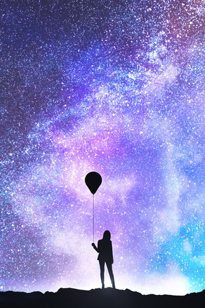 Businesswoman silhouette with balloon standing on beautiful starry sky background. Freedom and success concept