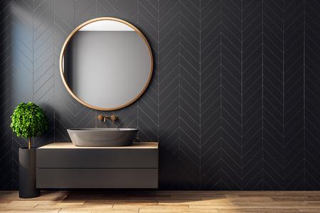 Interior de baño negro moderno con árbol decorativo, lavabo, espejo redondo, luz solar y espacio de copia. Representación 3D
