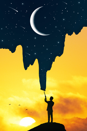 Businessman drawing beautiful starry sky and crescent on bright sunset background. Creativity and abstract concept