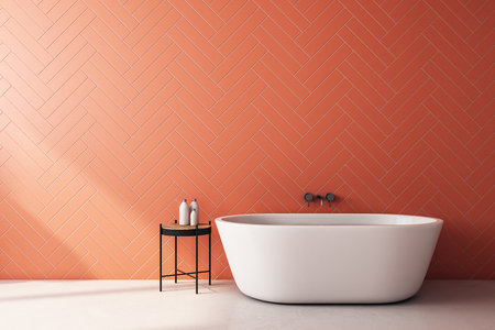 Modern orange bathroom interior with bath tub, sunlight and copy space. 3D Rendering
