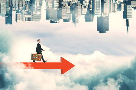 Businessman walking on red arrow looking on abstract sky background with clouds and upside-down city skyline. Growth and success concept Stok Fotoğraf