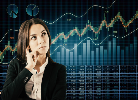 Attractive thoughtful european businesswoman with glowing forex chart. Broker and finance concept Imagens - 118912535